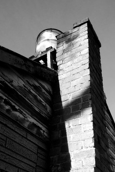 chimney & an old hot water drum on the roof